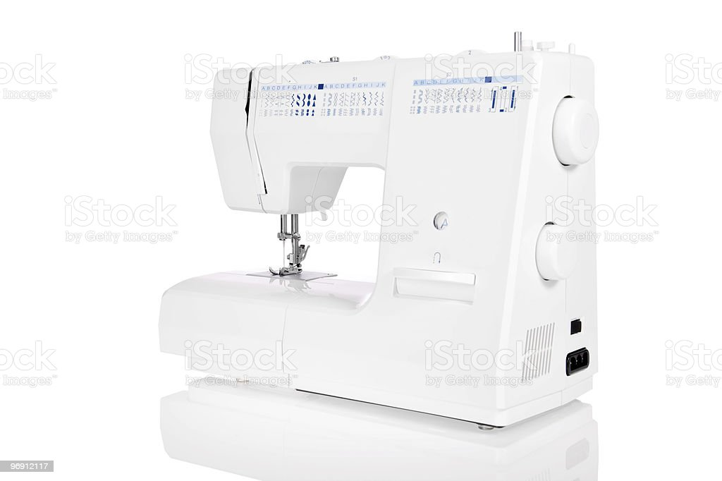 Modern electric sewing machine isolated on white royalty-free stock photo