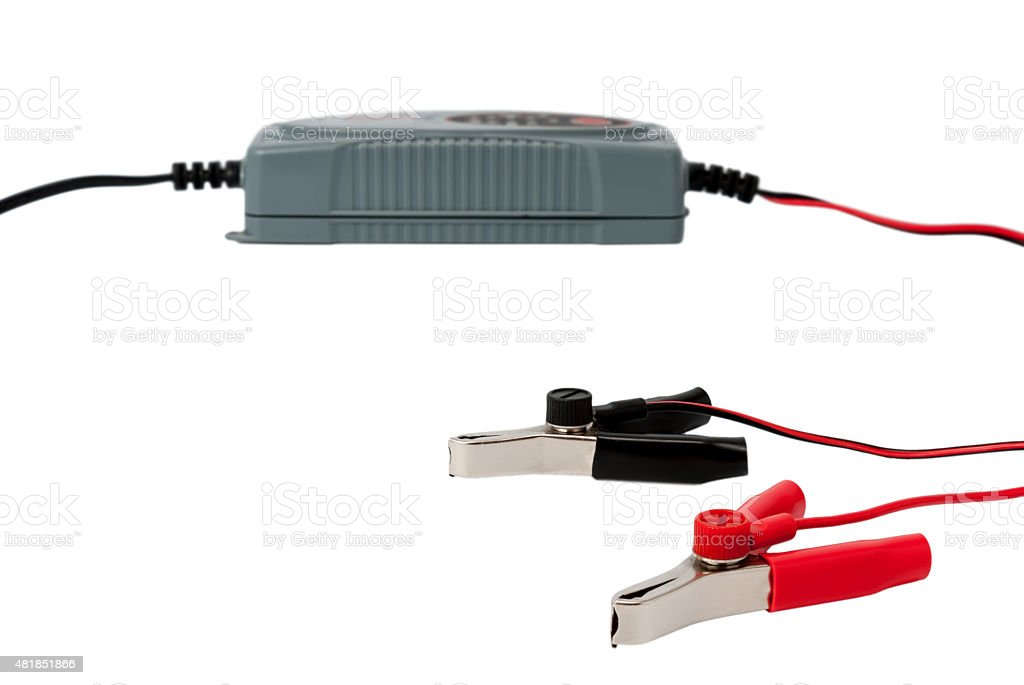 Modern electronic charger for car battery with clamps stock photo