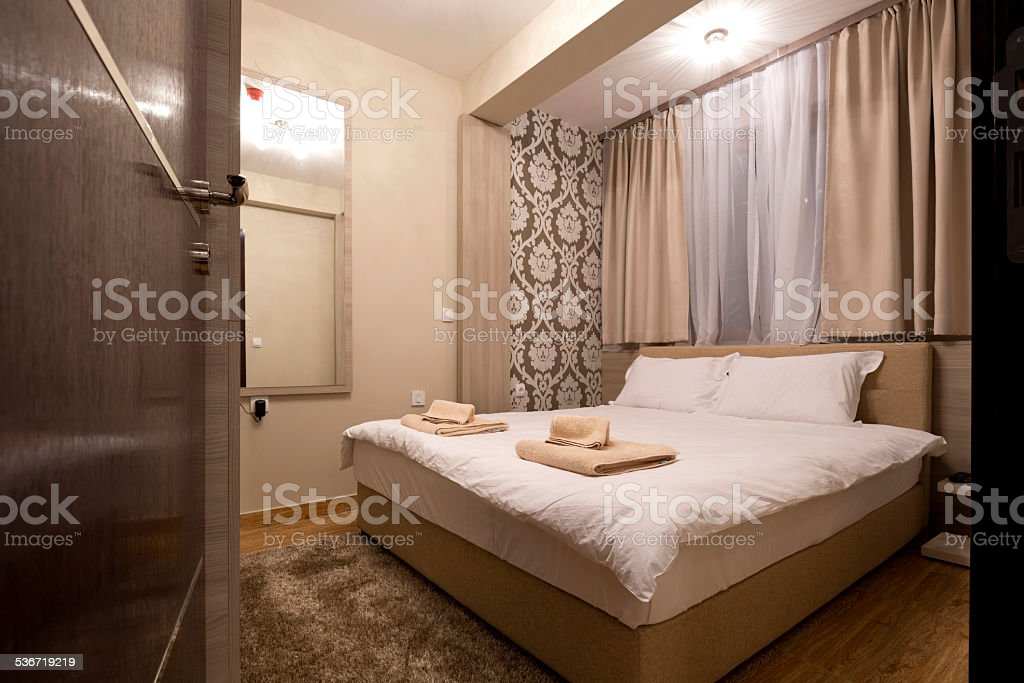 Modern elegant bedroom interior stock photo