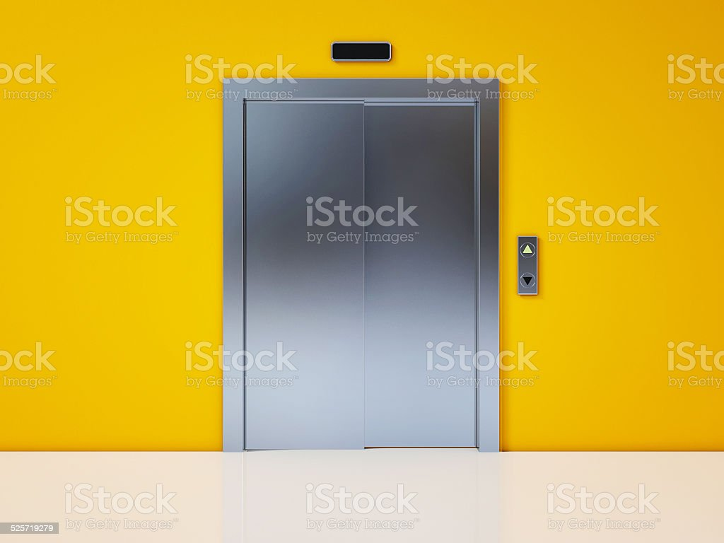 Modern Elevator with Closed Door on Yellow Wall stock photo