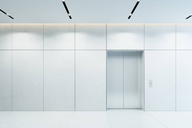 modern elevator with closed doors in office lobby stock photo