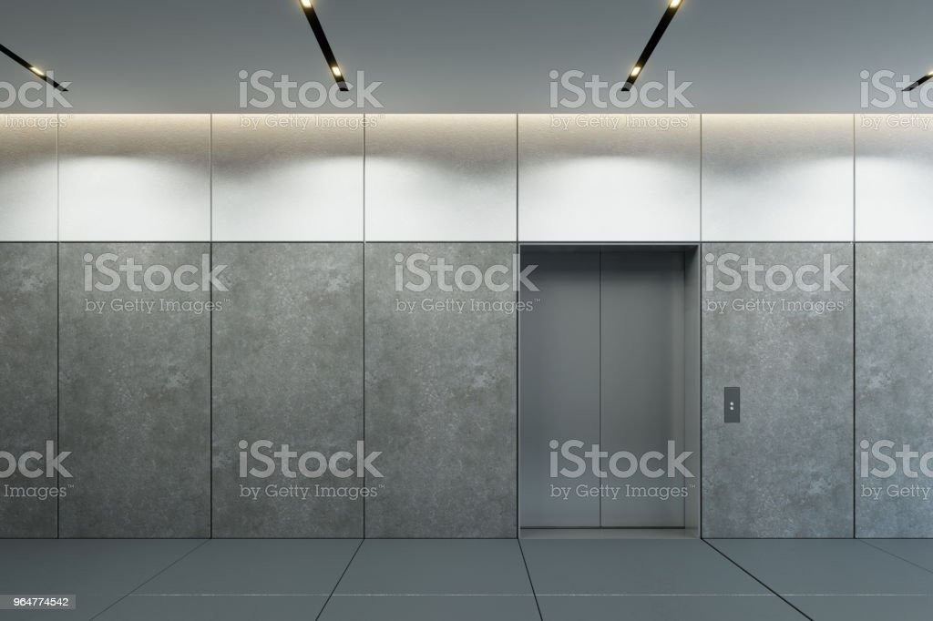modern elevator with closed doors in office lobby royalty-free stock photo