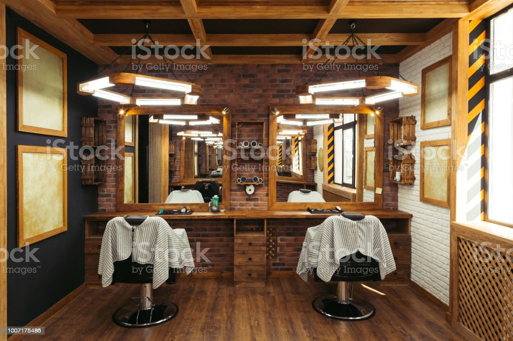 modern empty barbershop interior with chairs, mirrors and lamps - fotografia de stock
