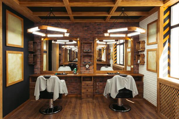 décoration salon de coiffure vide moderne avec des chaises, miroirs et lampes - barbier coiffeur photos et images de collection