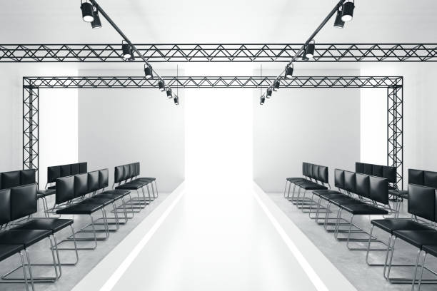 Modern empty fashion runway Modern empty fashion runway podium stage interior with seats, lights and copyspace. 3D Rendering ramp stock pictures, royalty-free photos & images