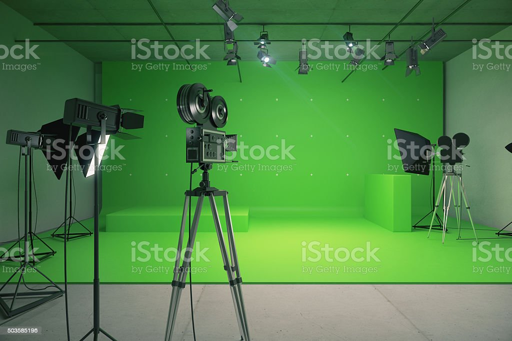 Modern empty green photo studio with  old style movie camera stock photo