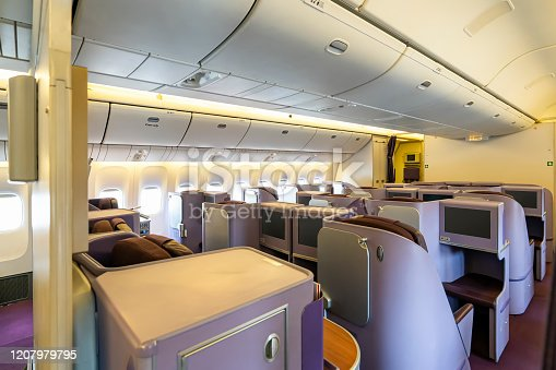 istock Modern empty Interior in the airplane or passenger plane while parking view from rear 1207979795