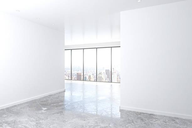 moderne leere loft zimmer mit großen fenster und weiße wand - betondecke stock-fotos und bilder