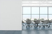 istock Modern Empty Office Room With White Blank Wall 1278293102