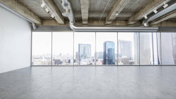 moderne leeren büroflächen im bankenviertel - betonboden wohnzimmer stock-fotos und bilder