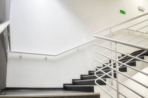 Modern empty staircase with white wall. stock photo