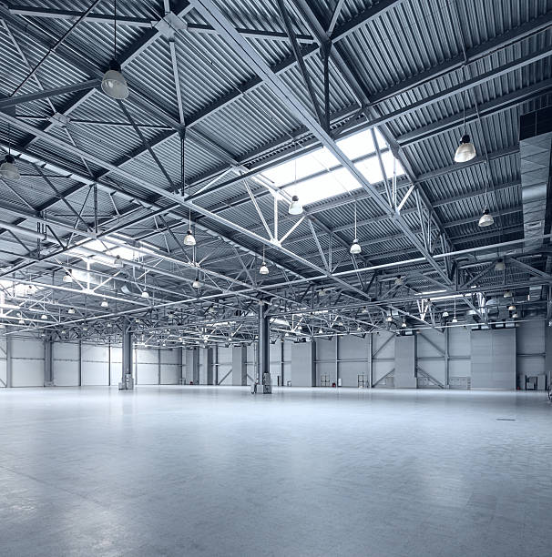 Modern empty storehouse Interior of empty warehouse warehouse interior stock pictures, royalty-free photos & images