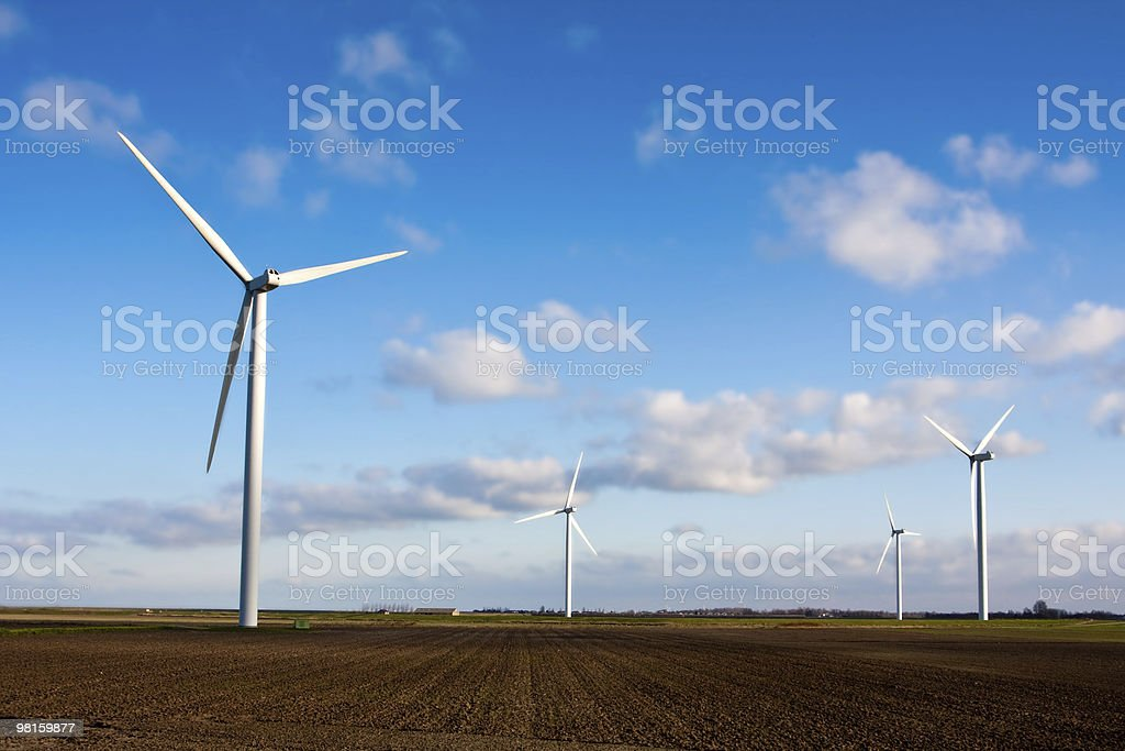 Modern energy generators in a field royalty-free stock photo