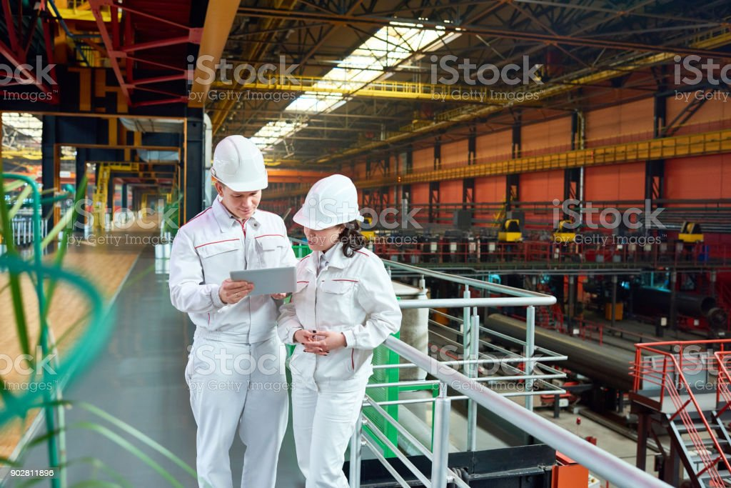 Modern engineer discussing manufacturing results stock photo