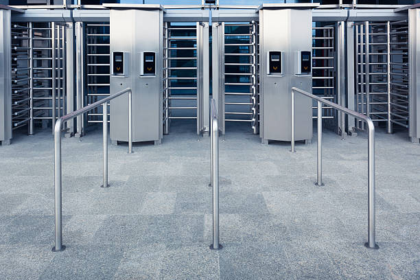 Modern entrance to a stadium A modern entrance gate to a stadium with card/ticket readers. security barrier stock pictures, royalty-free photos & images