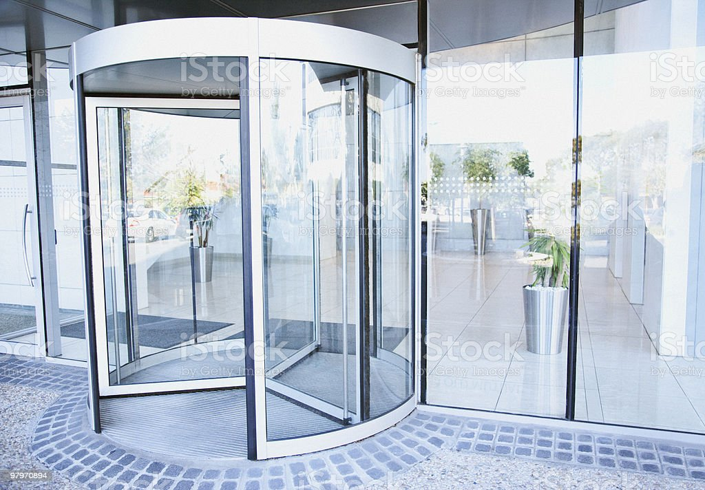 Modern entrance with revolving door stock photo