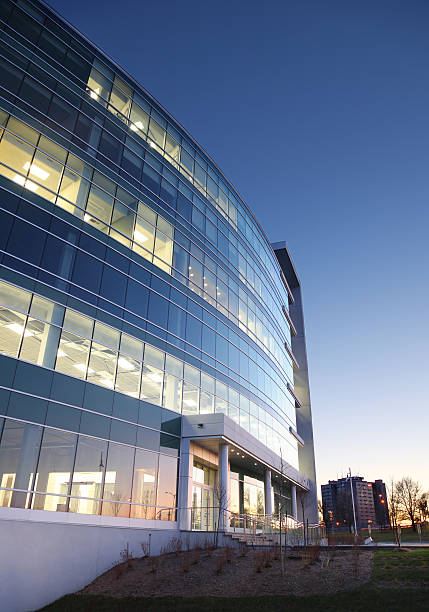 Modern Entreprise Exterior at Sunset  entreprise stock pictures, royalty-free photos & images