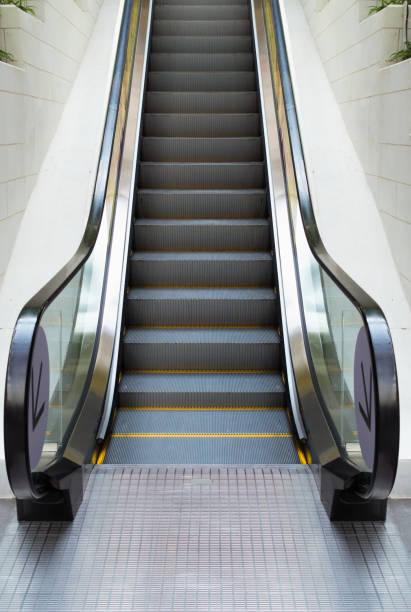 modern escalator in shopping mall, department store escalator - escalator foto e immagini stock