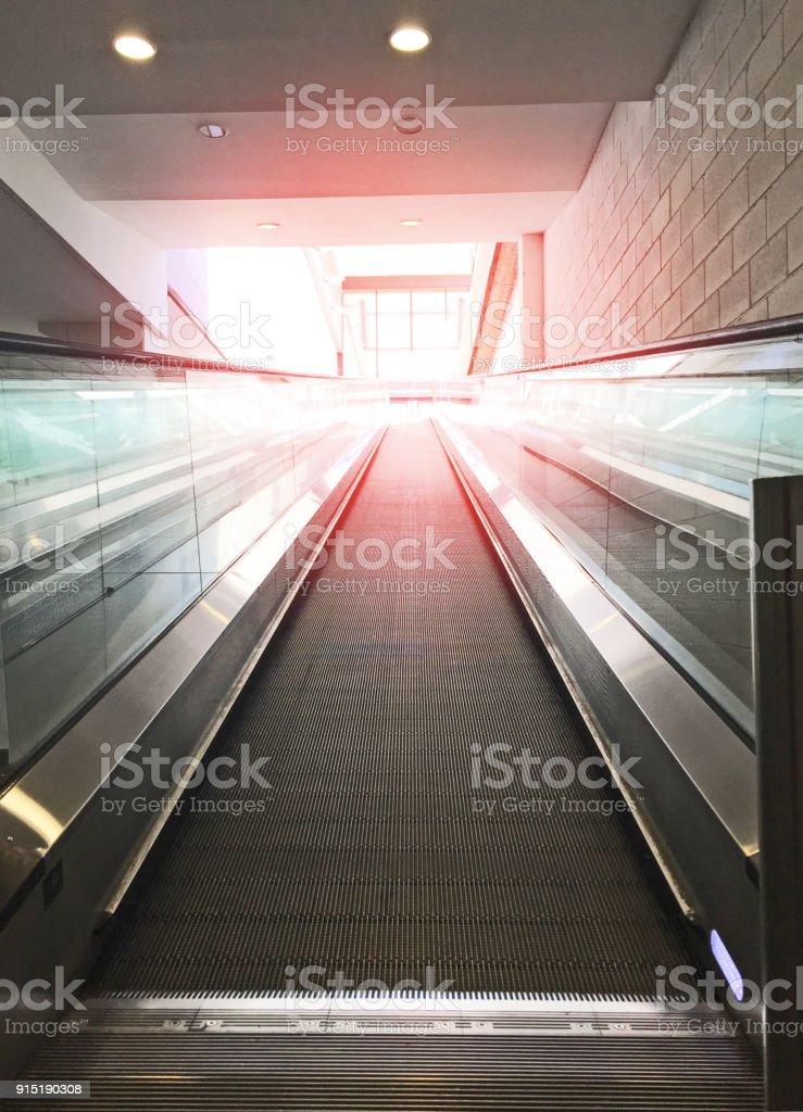 Modern escalator moving up stock photo