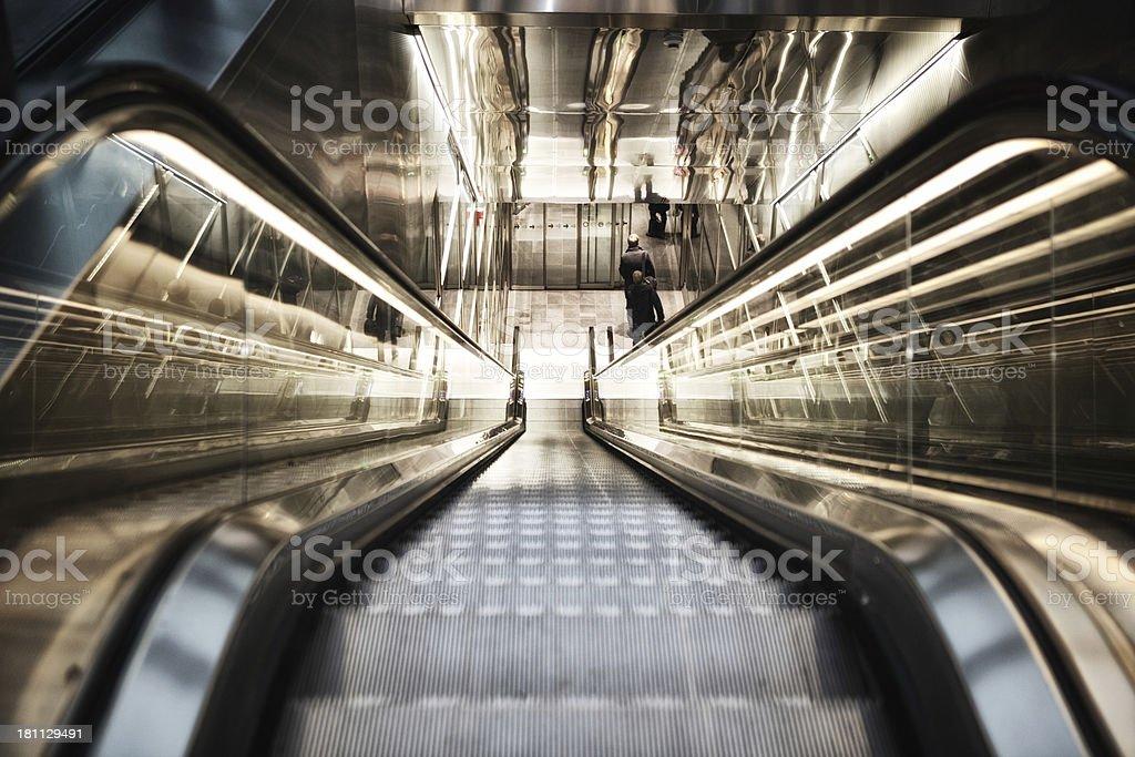 Modern escalator perspective royalty-free stock photo
