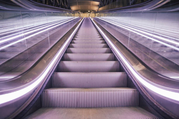 Modern Escalator Point of View from Bottom stock photo