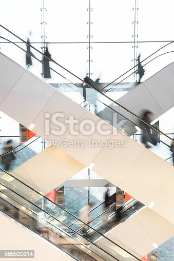 istock Modern Escalator with blurred people 585520314