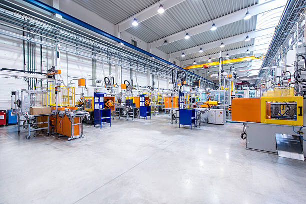 interni fabbrica moderna - metal robot in logistic factory foto e immagini stock