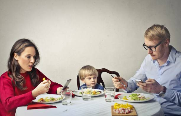 modern family dinner - eating technology stock photos and pictures
