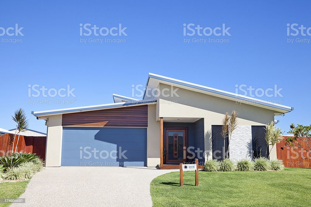Modern Family Home Front with blue sky copyspace stock photo