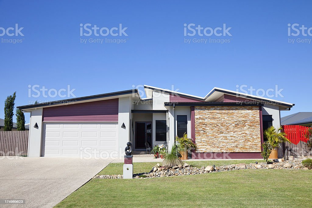 Modern Family Home Front with blue sky stock photo