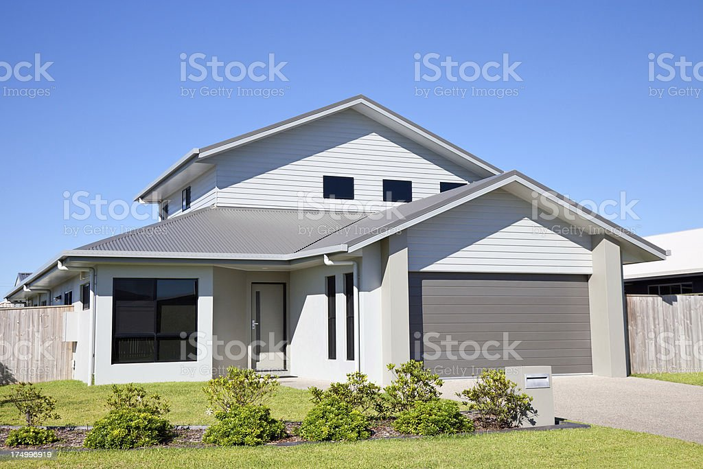 Modern Family Suburban Home with clear blue sky stock photo