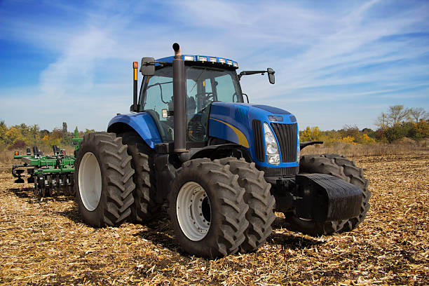 Modern farm tractor with planter stock photo