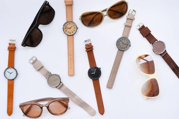Modern fashionable sunglasses and set of multicolored wristwatch – zdjęcie