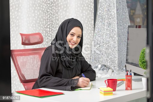 istock modern female Arabian office worker in office 918743242