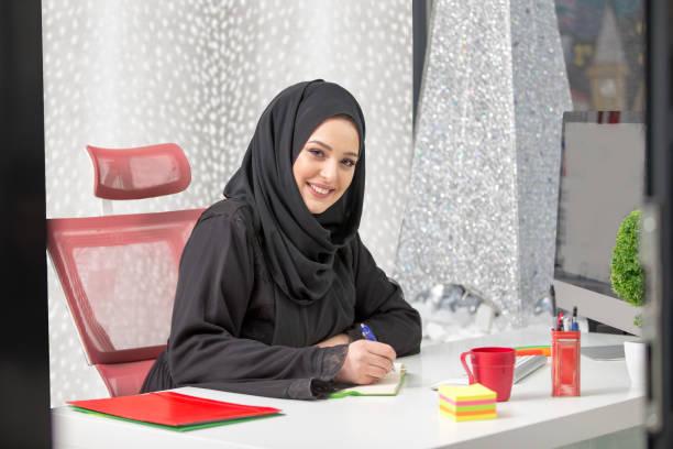 modern female Arabian office worker in office stock photo