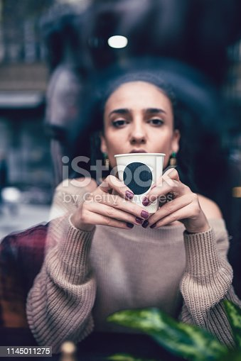 Modern Female Enjoying Take Away Coffee