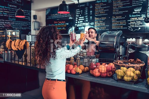 Modern Female Taking Smoothies From Barista