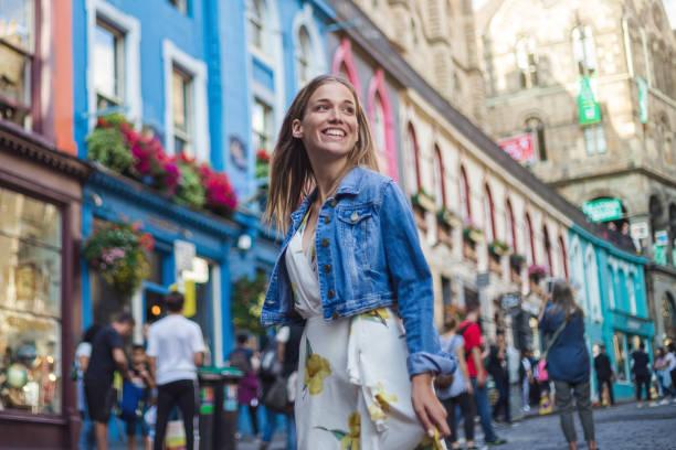 Modern female tourist spending excited day visiting Victoria street in Edinburgh stock photo