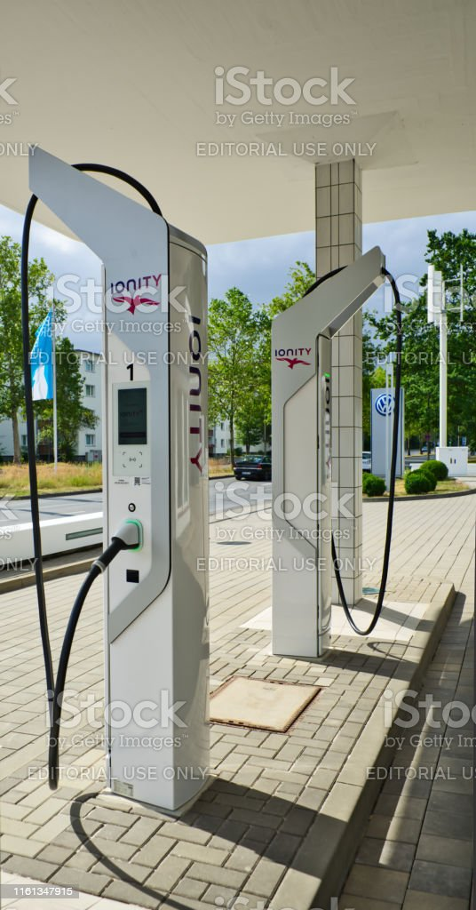 Modern filling station for electric cars with futuristic charging...