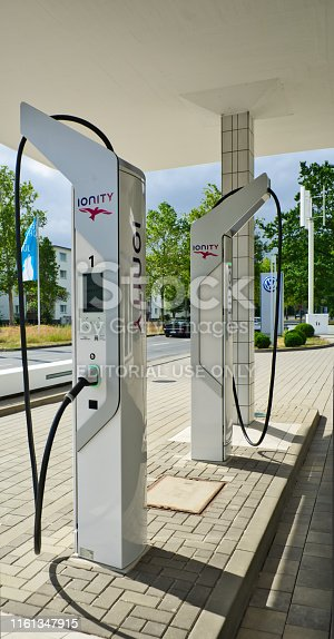 168589045 istock photo Modern filling station for electric cars with futuristic charging stations 1161347915