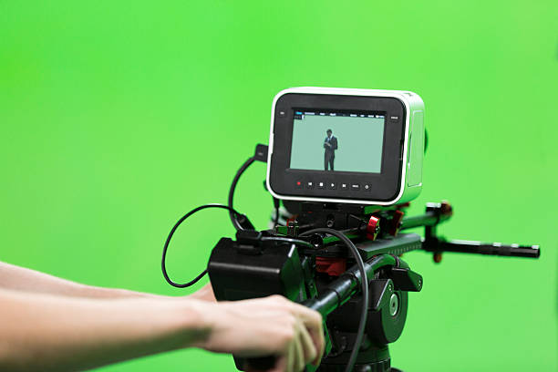 modern film studio with green screen and light equipment - green screen background stock photos and pictures
