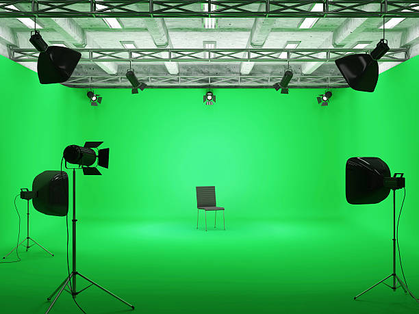 modern film studio with green screen and light equipment - green screen stockfoto's en -beelden