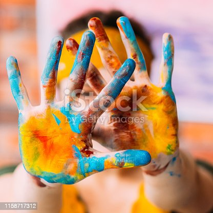 istock modern fine art course hands colorful paint 1158717312