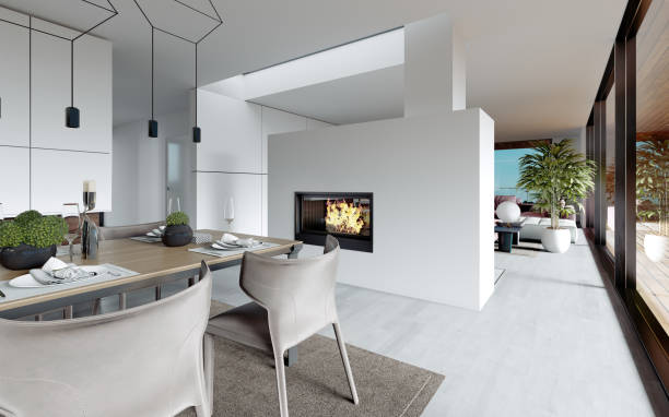 Modern fireplace with live fire between the living room and dining room. Design style of contemporary.