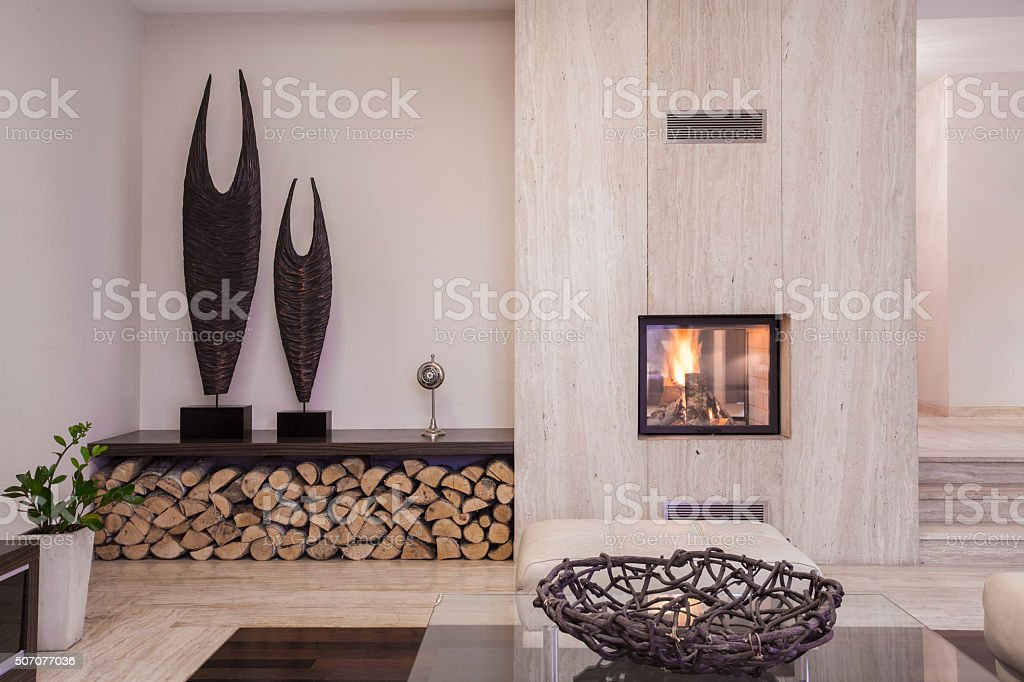 Modern fireplace with wood stock photo