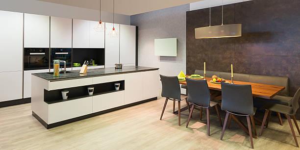 modern flat white kitchen with elegant wooden dinette – Foto