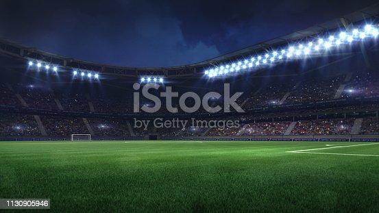 istock modern football stadium illuminated by floodlights and empty green grass 1130905946