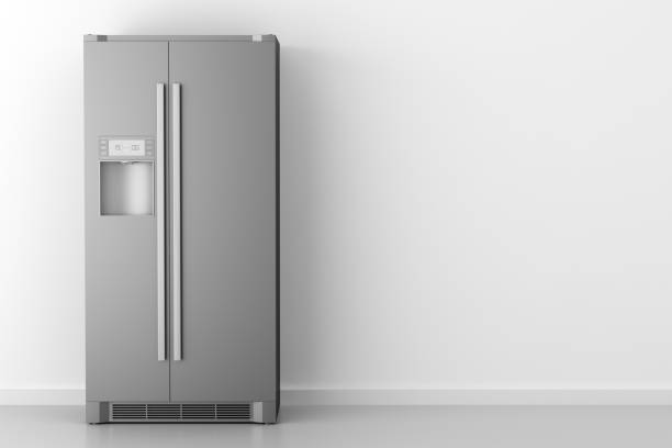 modern fridge in front of white wall stock photo