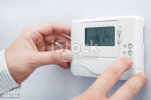 istock Modern furnace setting panel. Depth of field on the buttons 488874060