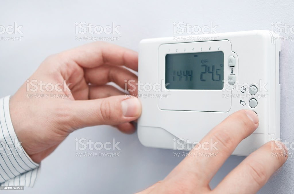 Modern furnace setting panel. Depth of field on the buttons stock photo